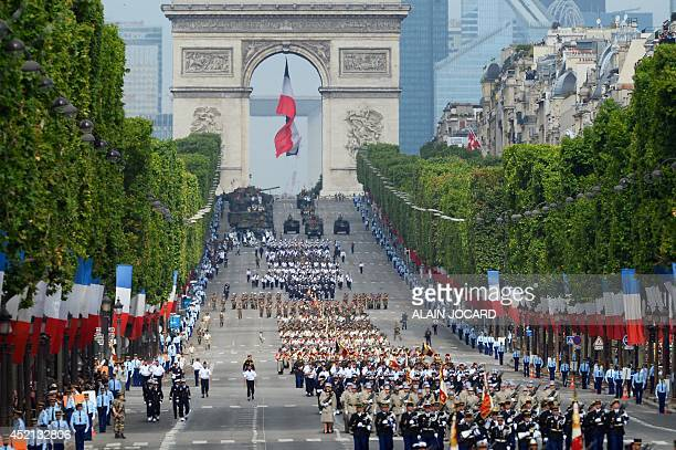 Troops march down the ChampsElysees avenue during the annual Bastille Day military parade in Paris on July 14 2014 AFP PHOTO / ALAIN JOCARD