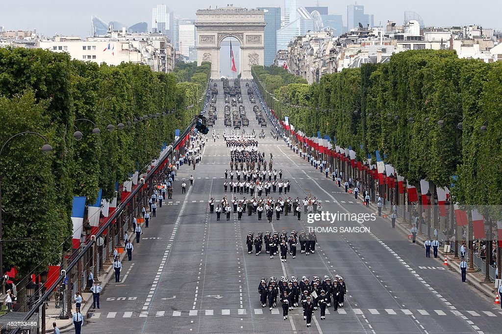 Troops march down the ChampsElysees avenue during the annual Bastille Day military parade in Paris on July 14 2014 AFP PHOTO / POOL / THOMAS SAMSON