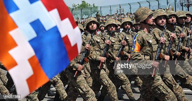 Troops of Azerbaijan's breakaway region of Nagorny Karabakh march in Stepanakert the capital of Nagorny Karabakh on May 9 during a military parade...