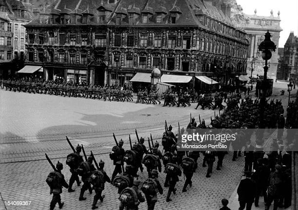 Troops of German soldiers marching near the town hall Lille 1914