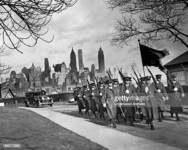 Troops of the 16th Infantry march on Governors Island as Major General Nolan in the autimobile behind them prepares to assume command of the post New...