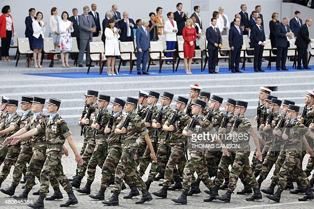Troops of the 28 geographic group march down the Champs Elysees in front of Paris mayor Anne Hidalgo French National Assembly President Claude...