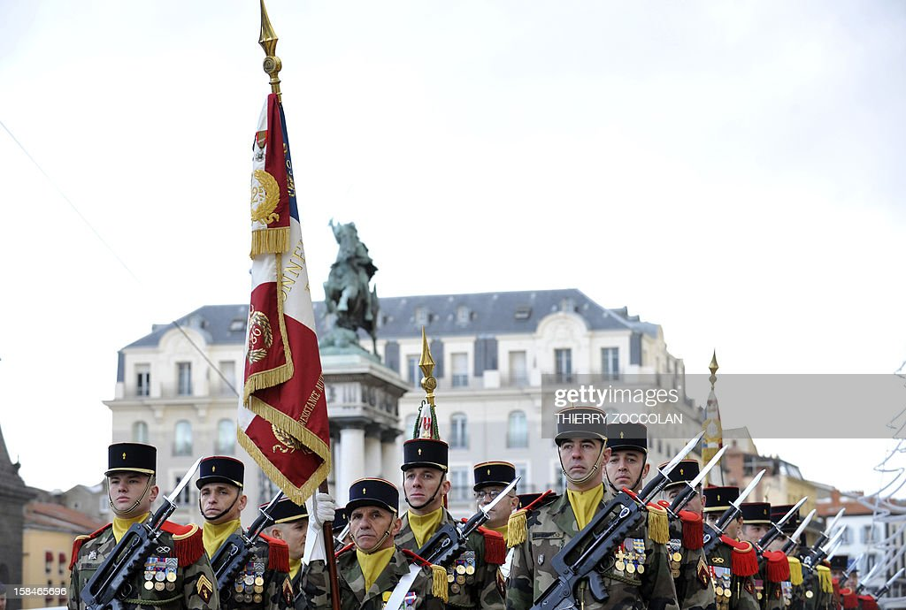 Troops of the 2nd Engineer French Foreign Legion Regiment stand with their flag, on December 17, 2012 in Clermont-Ferrand, central France, during a ceremony marking the dissolution of a joint tactical bataillon that served in Afghanistan from May to November 2012. France joined the NATO coalition in late 2001 to help prop up the new government against an insurgency, which began after a US-led invasion toppled the Taliban government earlier that year for giving refuge to Osama bin Laden and his Al-Qaeda network, following the 9/11 attacks on New York and Washington. ZOCCOLAN