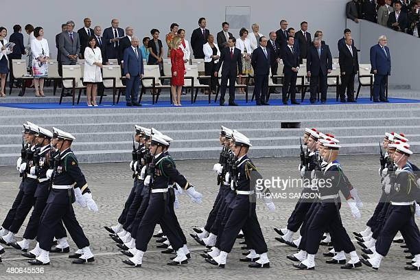 Troops of the CharlesdeGaulle aircraft carrier march down the Champs Elysees in front of Paris mayor Anne Hidalgo French National Assembly President...