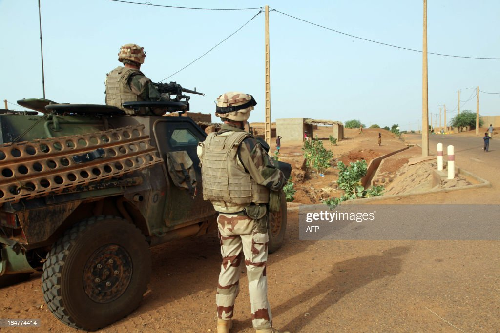 Troops of the Frenchled Serval Operation in Mali patrol an area in Gao on October 16 2013 A year after Islamist fighters took the upper hand in...