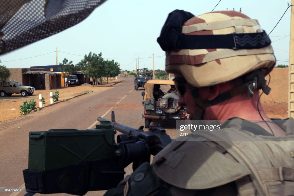 Troops of the Frenchled Serval Operation in Mali patrol an area on the outskirts of Gao on October 16 2013 A year after Islamist fighters took the...