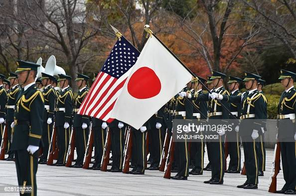 TOPSHOT Troops of the Japanese Self Defence Force ceremony corps welcome to US Defense Secretary Ashton Carter during an honour guard prior to talks...