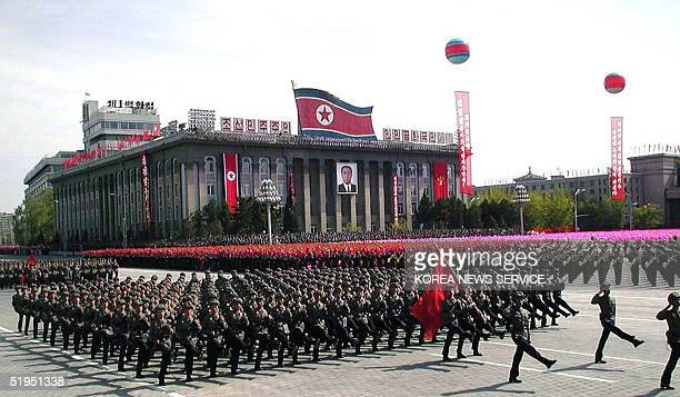 Troops parade in Pyongyang 25 April 2002 to celebrate the 70th anniversary of the founding of Korean People's Army Thousands of troops swore...