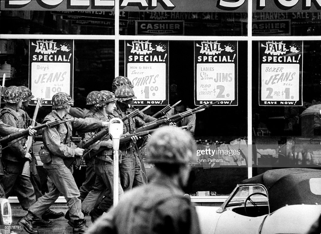 US troops patroling streets during riots vs enrollment of African American, James H. Meredith, at Univ. of Mississippi.