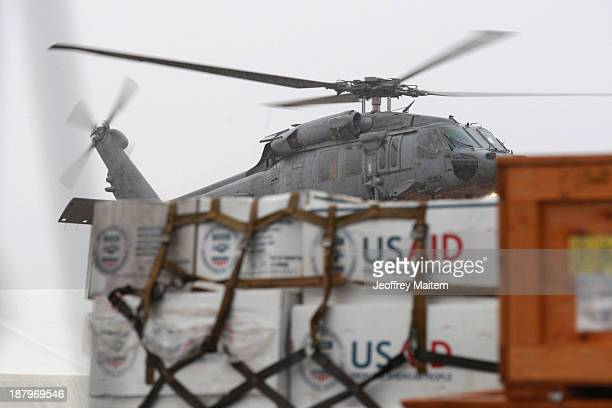 US troops prepare relief supplies for distribution to survivors of Typhoon Haiyan on November 14 2013 in Tacloban Leyte Philippines Typhoon Haiyan...