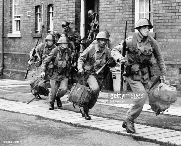 Troops sprint from their barracks in Holywood near Belfast to board a truck to take up guard duty