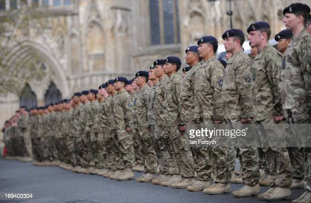 Troops stand to attention in front of York Minster as over 300 soldiers marched through the city streets on May 24 2013 in York England The soldiers...
