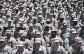 US troops with the Third Infantry Division Headquarters await US President Barack Obama and First Lady Michelle Obama at Fort Stewart in Hinesville...