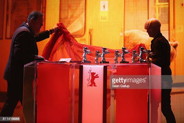 Trophies are being prepared on stage during the closing ceremony of the 66th Berlinale International Film Festival on February 20 2016 in Berlin...