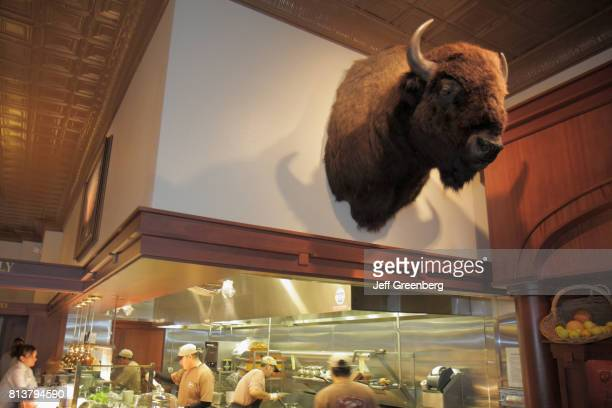 A trophy bison head above the open kitchen at Ted's Montana Grill