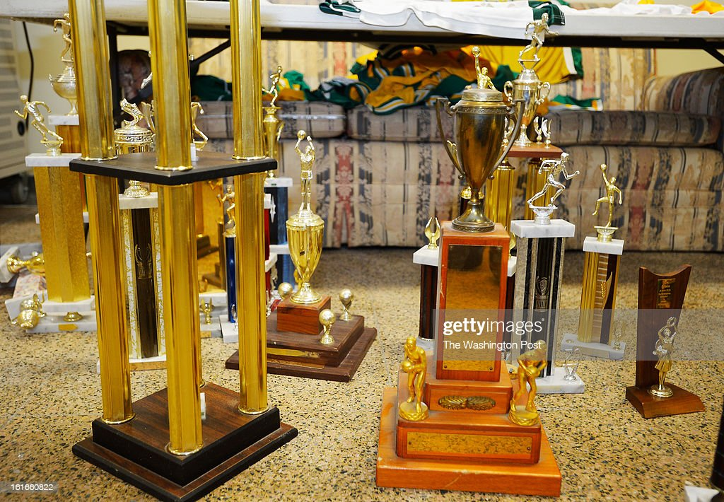 A trophy, center right, from the 1960 team the Elgin Baylor played on, sits on the floor of the Spingarn athletic laundry room where it is stored the end of Spingarn's basketball program as the school closes at Spingarn High School in Washington DC, February 12, 2012 .