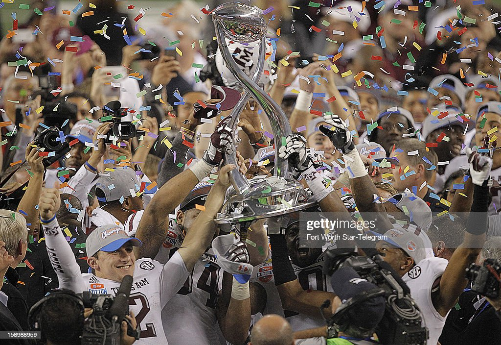 Trophy in hand, the Texas A&M squad celebrates after a 41-13 win over Oklahoma in the AT&T Cotton Bowl game in Cowboys Stadium in Arlington, Texas, on Friday, January 4, 2013.