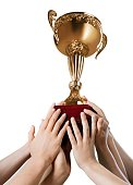 Hands holding golden trophy on a white background