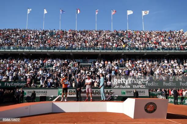 Trophy presentation after the men's singles final with Novak Djokovic French Tennis Federation President Jean Gachassin Stan Wawrinka and Gustavo...