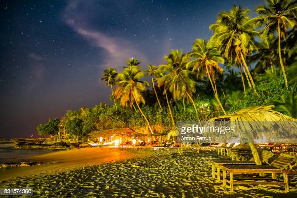 Tropical beach at night under the starry sky