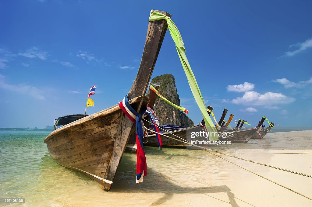 Tropical beach landscape. Thai long tail boats at ocean coast : Stock Photo