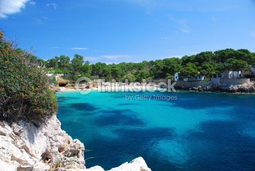 Tropical beach with blue water at Mallorca : Stock Photo