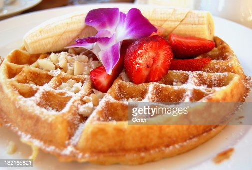 Tropical Belgian Waffle breakfast with Fruit and Macadamia Nuts