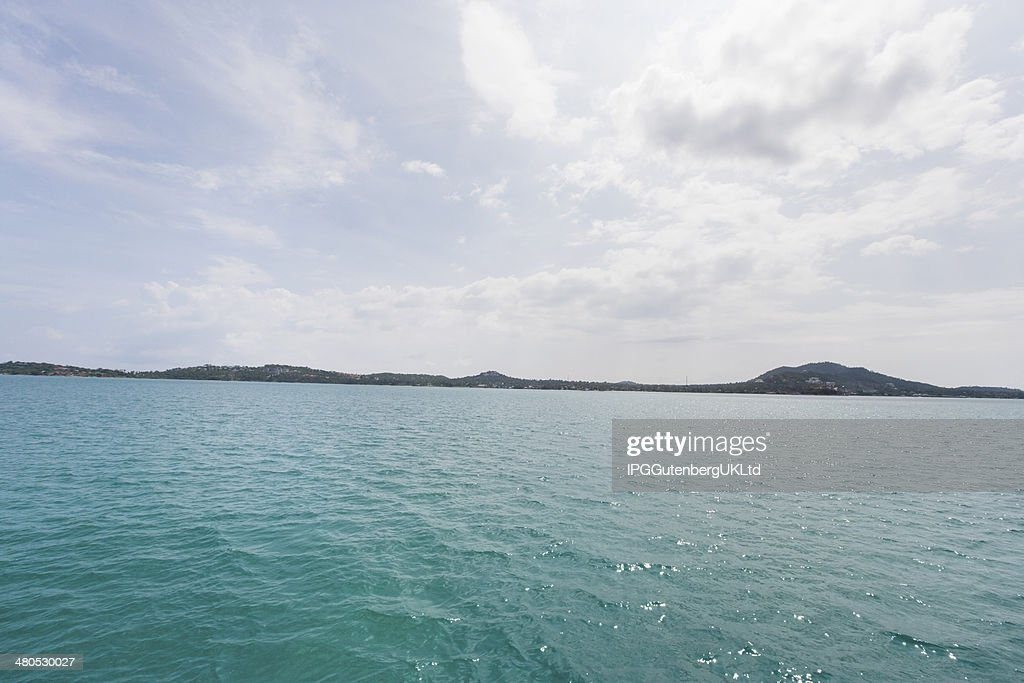 Tropical blue sea with island in background; Koh Samui; Thailand : Stock Photo