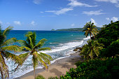 view of grand anse beach grenada with people enjoying the beach and sea