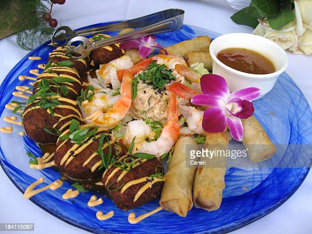 Tropical feast with shrimp, crab cakes and spring rolls