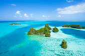 Aerial view of lush green tropical islands, coral reef and clear blue water, Palau, Micronesia