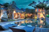 A modern tropical villa at sunset