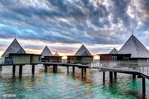 Tropical Paradise Luxury Over Water Resort at Sunset