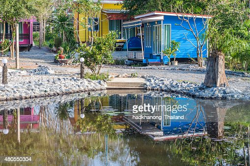 Tropical resort bungalow with pond in Thailand : Stock Photo