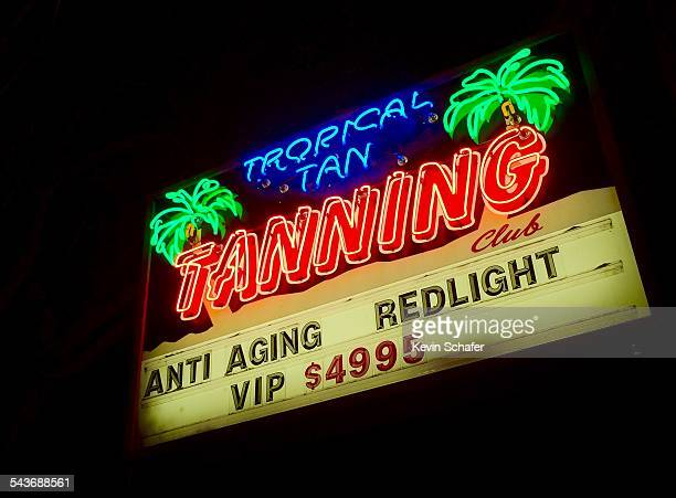 'Tropical Tan Tanning' neon sign for tanning bed service Wallingford district Seattle March 8 2015