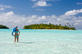 Luxury vacation - Young woman in a bikini in a tropical lagoon in Fiji in the South Pacific Ocean.