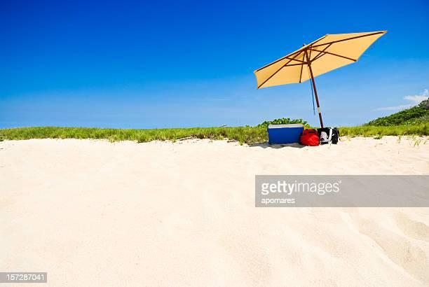 Tropical white sand beach with umbrella