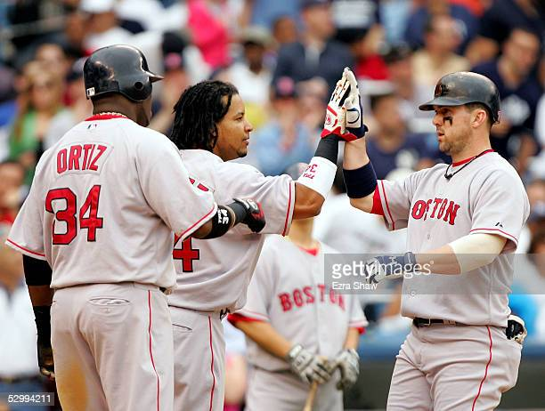 Trot Nixon of the Boston Red Sox celebrates with teammates David Ortiz and Manny Ramirez after hitting a threerun homerun in the fifth inning to give...