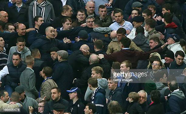 Trouble breaks out between Millwall supporters during the FA Cup with Budweiser Semi Final match between Millwall and Wigan Athletic at Wembley...