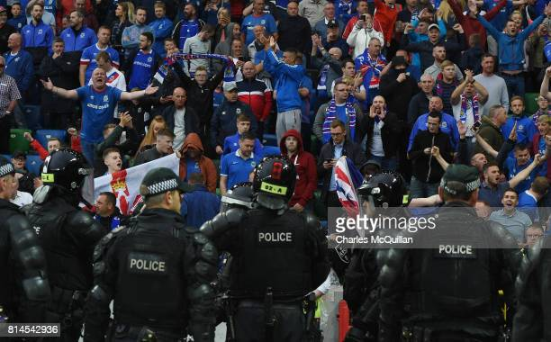 Trouble erupts in the Linfield supporters section after Leigh Griffiths of Celtic tied a Celtic scarf onto a goalpost following the Champions League...
