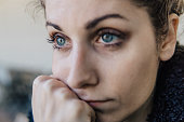 Portrait of beautiful thoughtful young woman with blue eyes