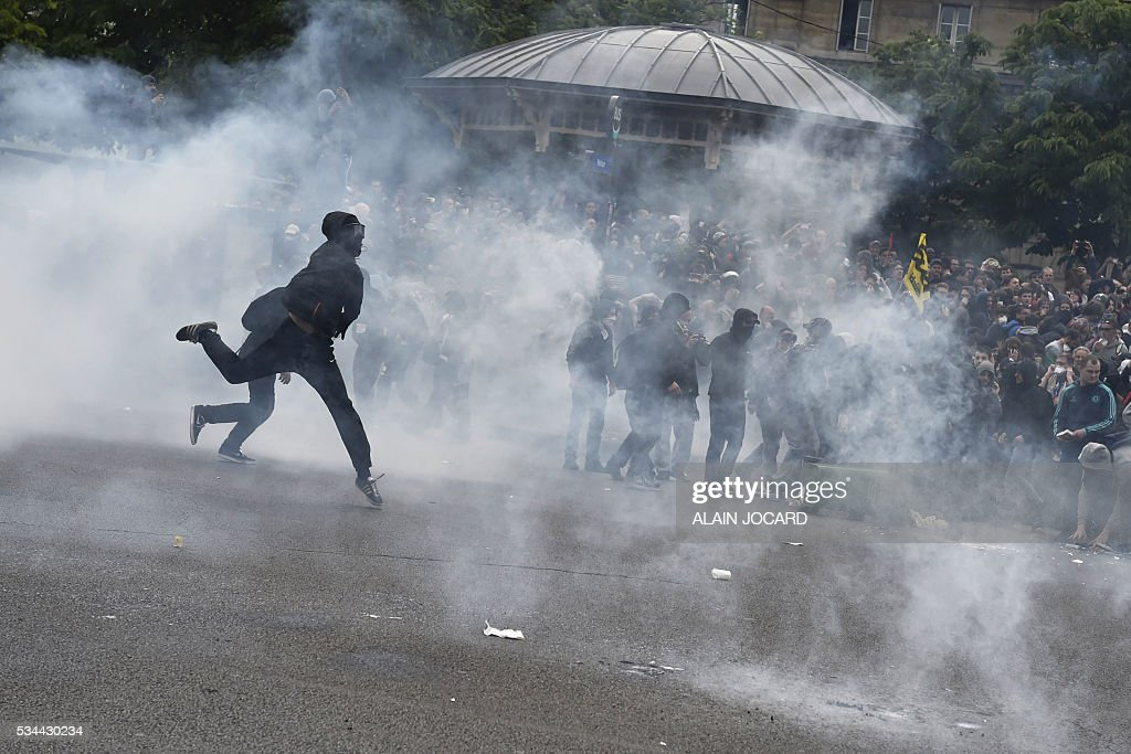 Troublemakers clash with French riot police on the Place de la Nation, during a protest against the government's labour market reforms in Paris, on May 26, 2016. The French government's labour market proposals, which are designed to make it easier for companies to hire and fire, have sparked a series of nationwide protests and strikes over the past three months.