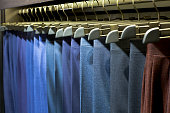 Many Pants on hangers in a shop