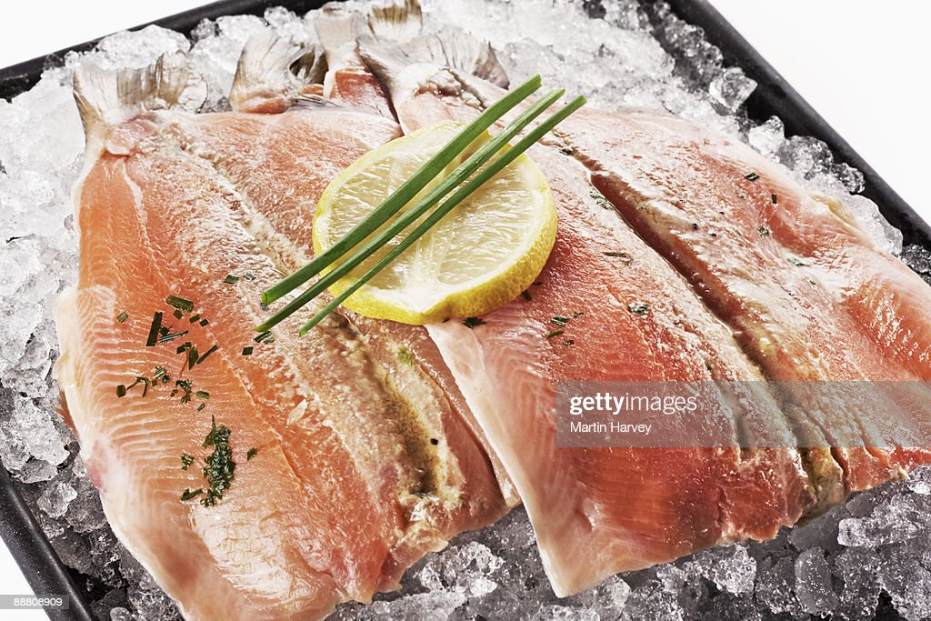 Trout fillets on crushed ice. : Stock Photo
