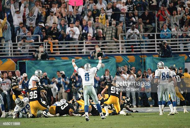 Troy Aikman of the Dallas Cowboys celebrates after the Cowboys scored a touchdown against the Pittsburgh Steelers during Super Bowl XXX on January 28...