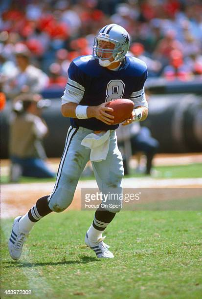 Troy Aikman of the Dallas Cowboys drops back to pass against the Atlanta Falcons during an NFL football game September 17 1989 at AtlantaFulton...