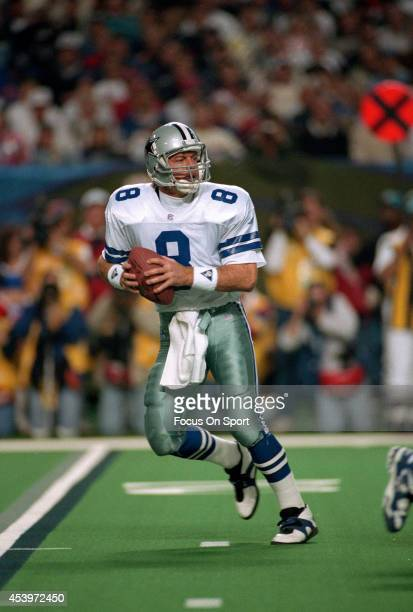 Troy Aikman of the Dallas Cowboys drops back to pass against the Buffalo Bills during Super Bowl XXVIII on January 30 1994 at the Georgia Dome in...