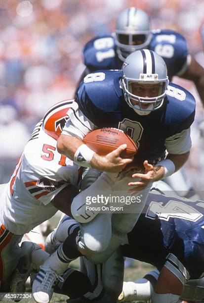 Troy Aikman of the Dallas Cowboys gets tackled by Marcus Cotton of the Atlanta Falcons during an NFL football game September 17 1989 at AtlantaFulton...