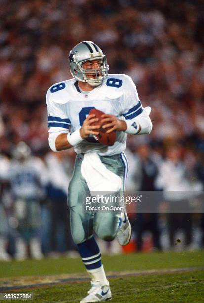 Troy Aikman of the Dallas Cowboys rolls out to pass against the Buffalo Bills during Super Bowl XXVII on January 31 1993 at The Rose Bowl in Pasadena...