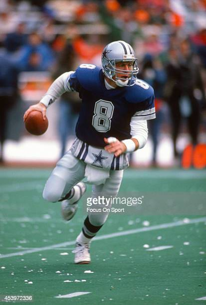 Troy Aikman of the Dallas Cowboys runs with the ball during an NFL football game circa 1996 Aikman played for the Cowboys from 198900